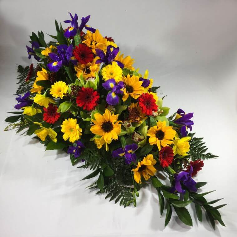 Bright funeral flowers on a casket