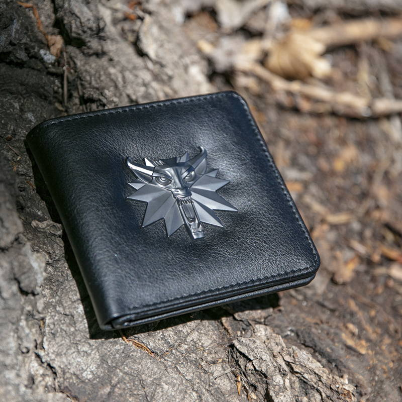 Photo of a black wallet with a Witcher logo