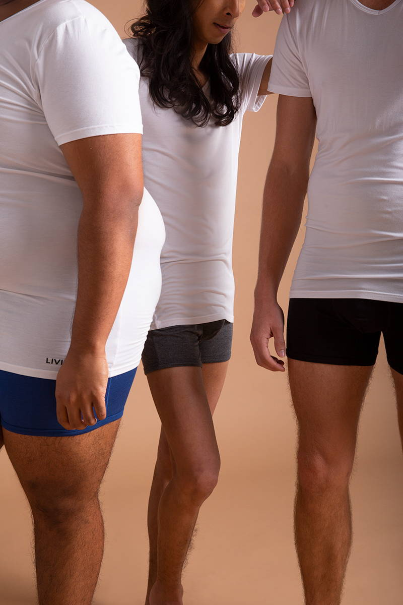 Men modelling the Livingwear v-neck undershirt and boxer briefs in different sizes