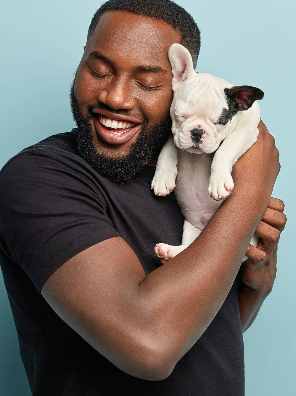 Man Smiling Holding A Dog