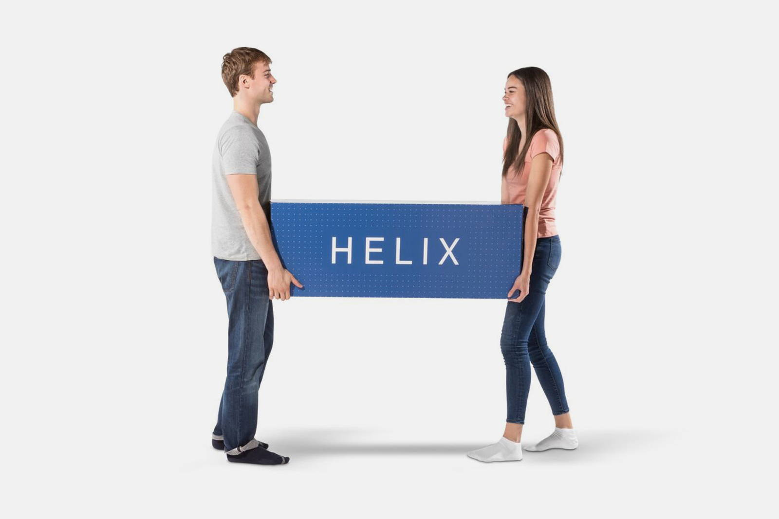 A couple moving their new Helix Mattress box