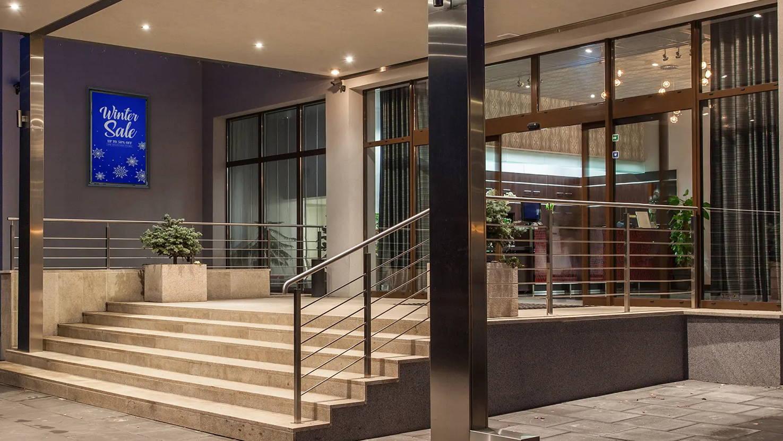 Outdoor digital signage portrait - vertical at hotel, resort, motel, hospitality