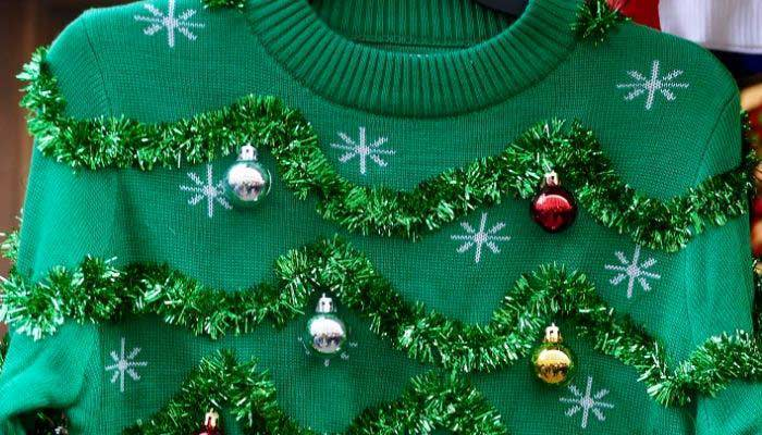 Green sweater with tinsel and ugly design