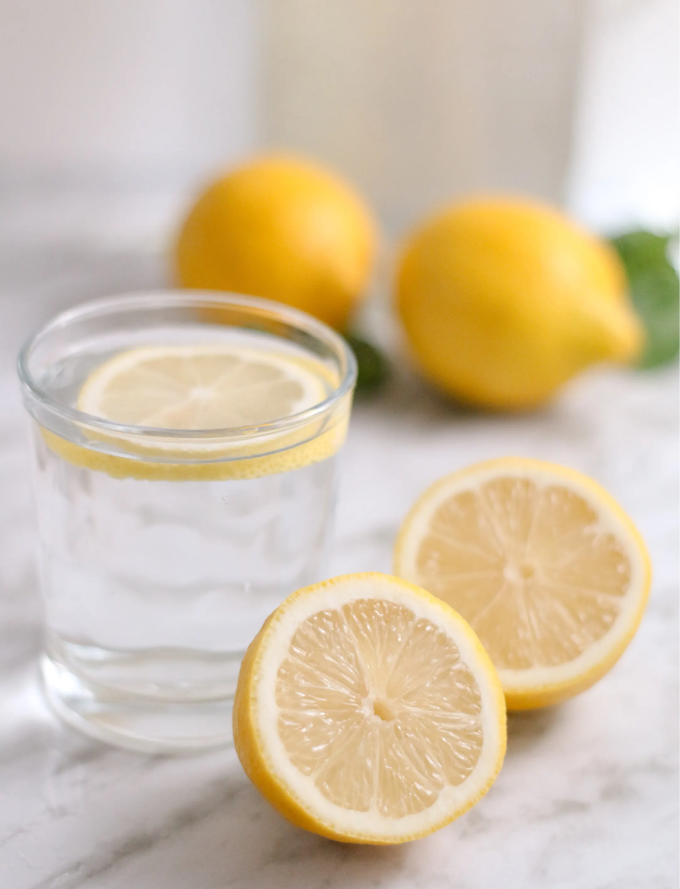Glass of water with sliced lemons