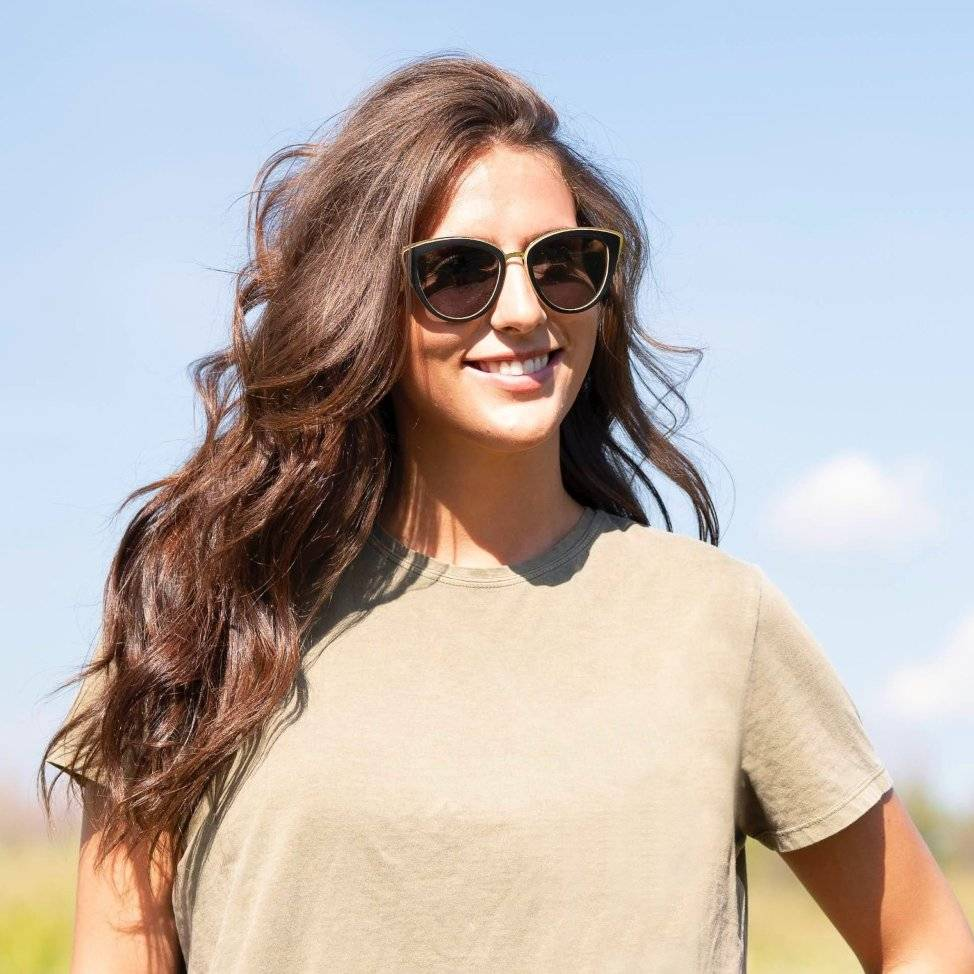 Woman wearing Kraywoods Willow, Cat Eye Sunglasses made from Bamboo wood with polarized dark lenses