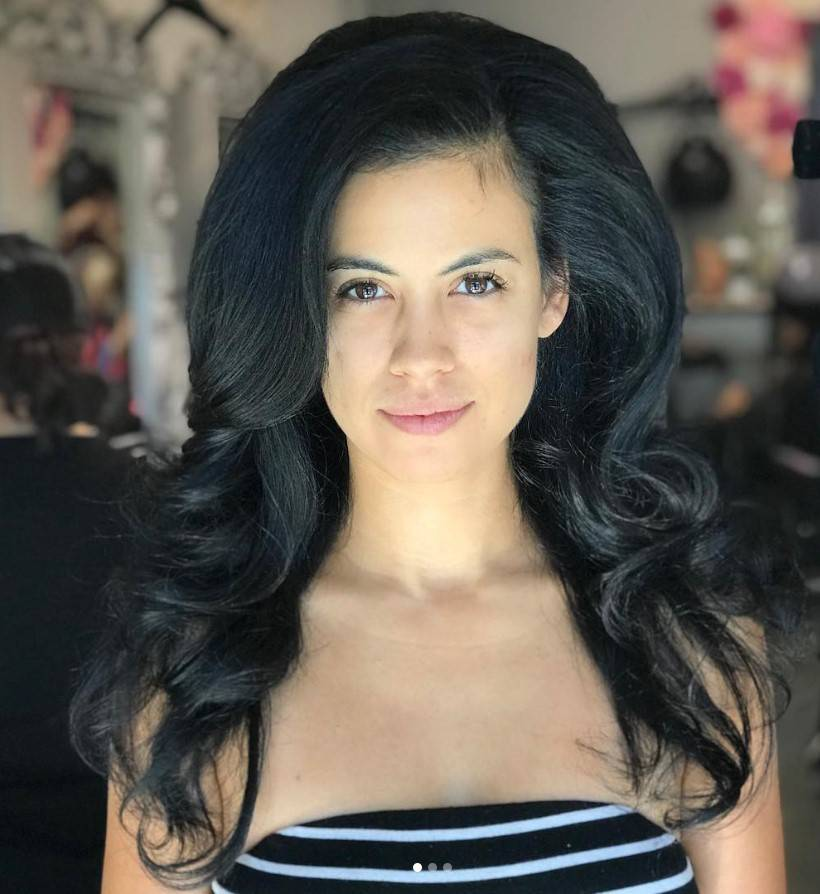 Girl with thick, long black hair