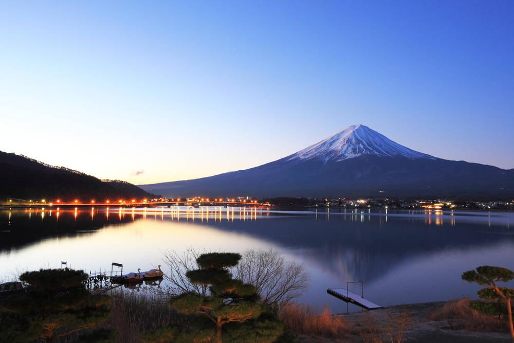 Mount Fuji is reflected at dawn in Lake Kawaguchi, one of Fuji's five lakes