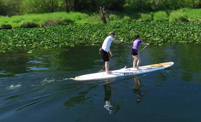 Duo tandem pau hana stand up paddle board on the lake
