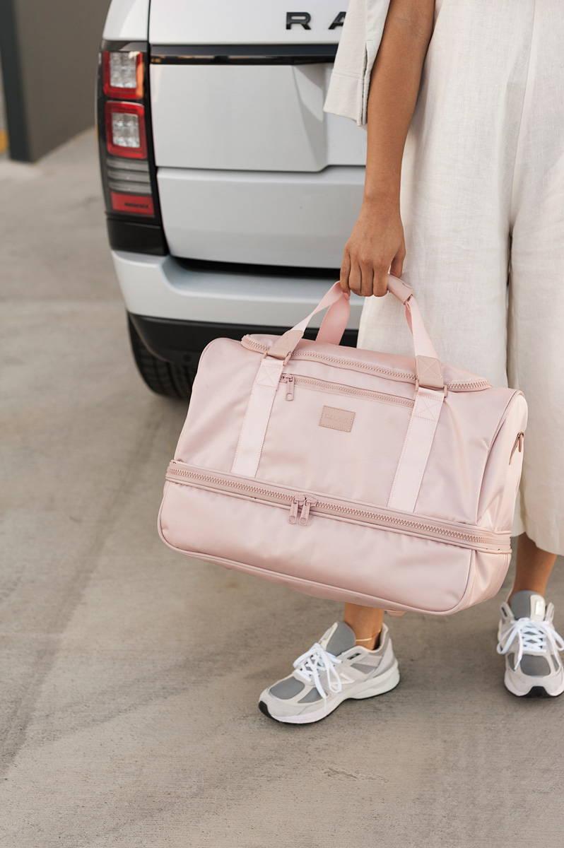 CALPAK Stevyn Duffel Bag in Pink Sand.
