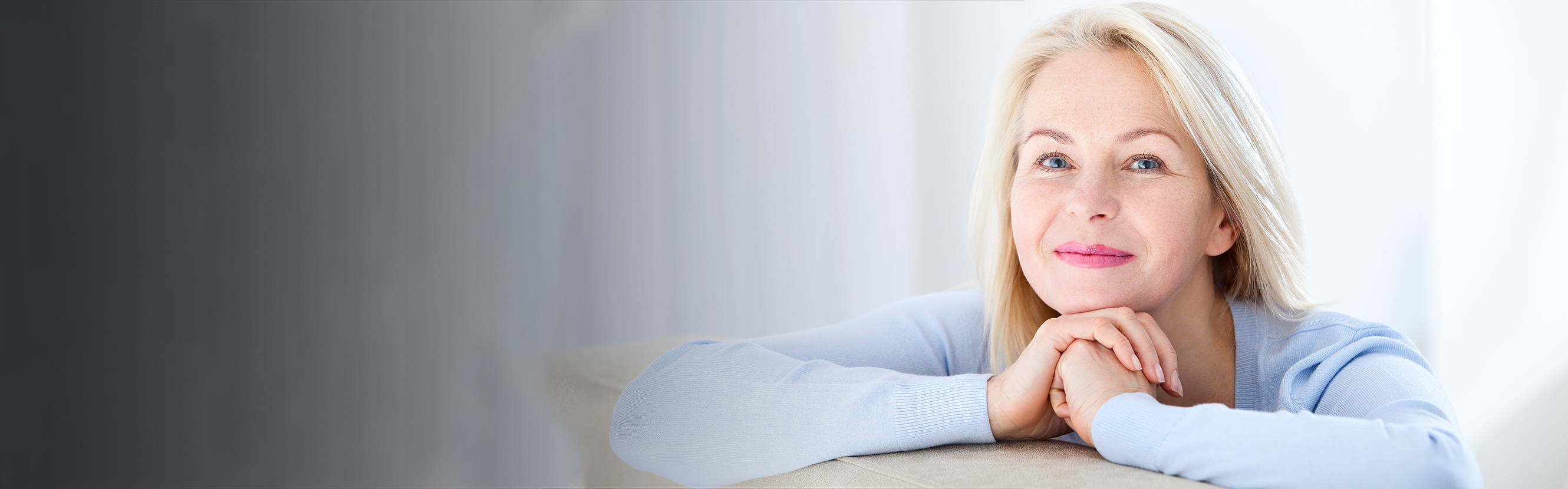 Woman With Blonde Hair Smiling