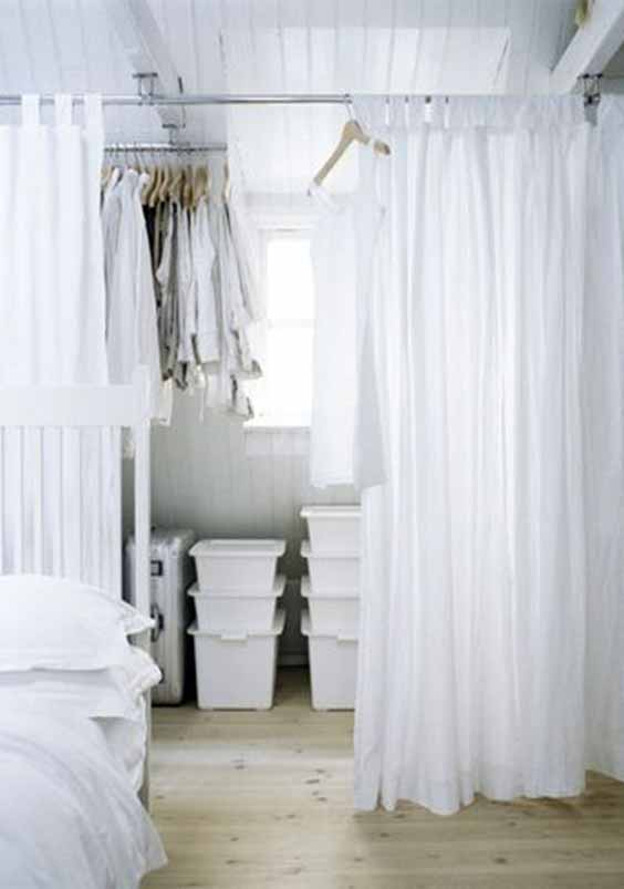 Use curtains instead of doors on wardrobe doors in small spaces