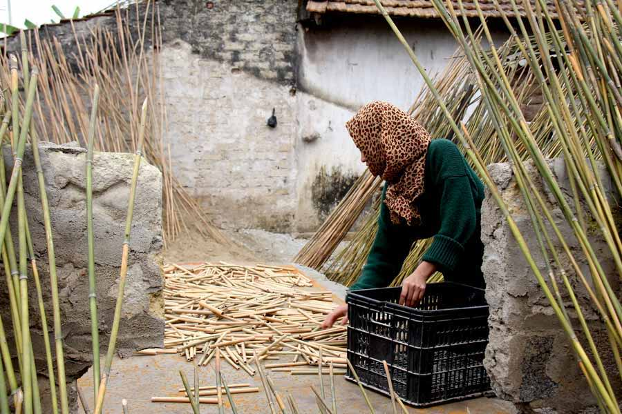 drying individual bamboo straws in Vietnam farm