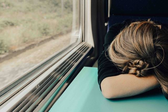 Person Sleeping On A Train