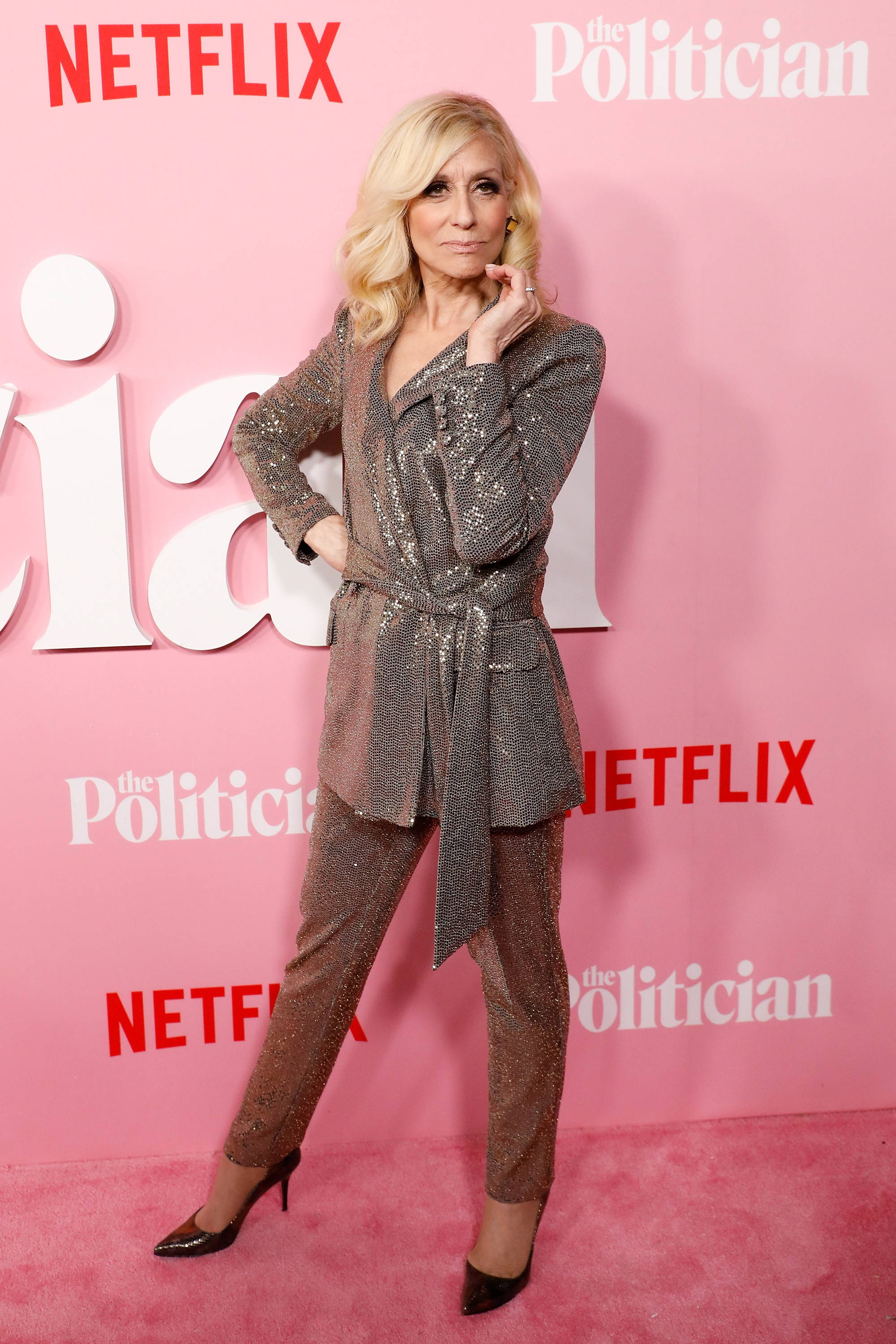 """Judith Light wearing the liquid sequin gold wrap evening suit from the Badgley Mischka fall 2019 collection at the premiere of """"The Politician"""""""