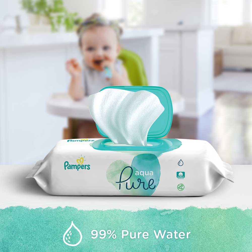 Pampers Aqua Pure Wipes Are Made 99% Water Wipes Pack on Counter with Baby in Highair in Background
