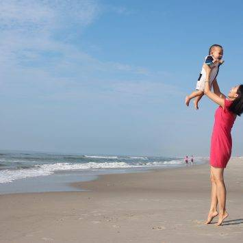Mother With Baby On The Beach