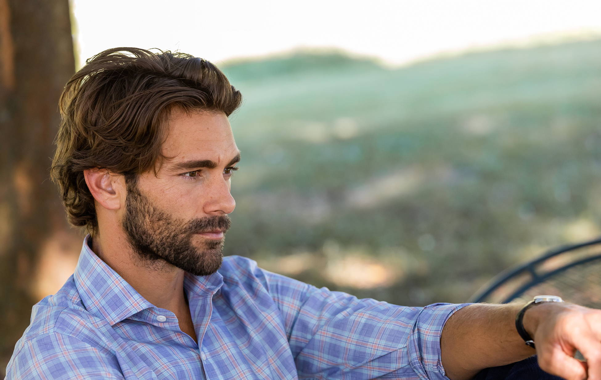 A man outdoors wearing the Khal Check casual shirt.