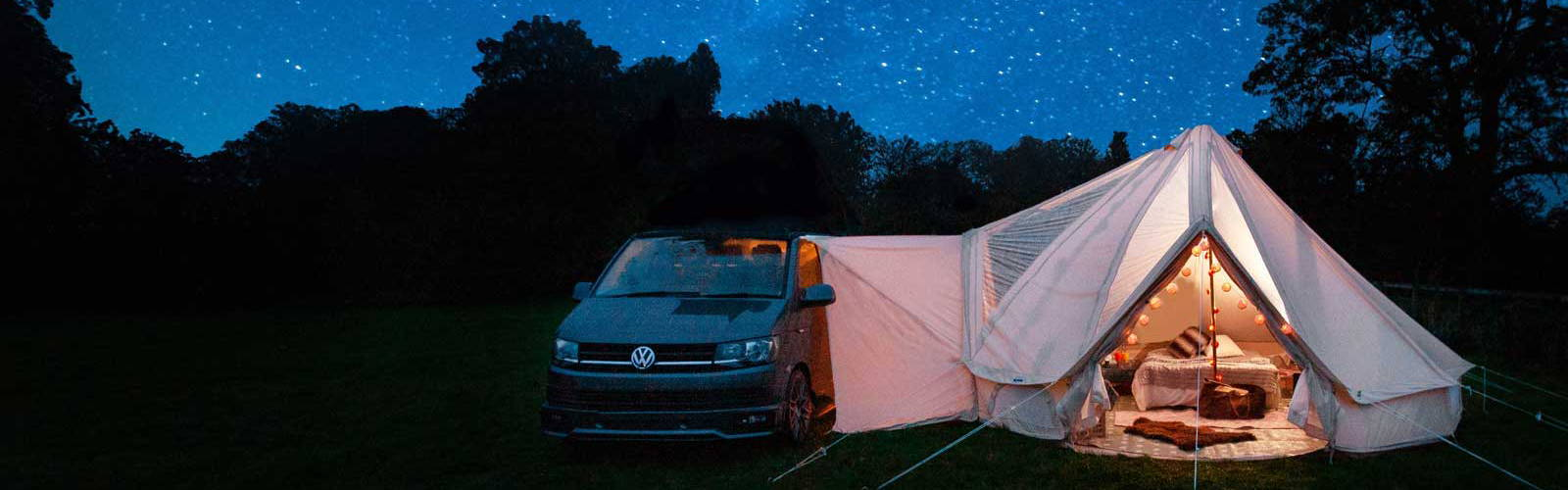 VW T6 attached to 5m cloudgazer glawning lit up with a background of stars