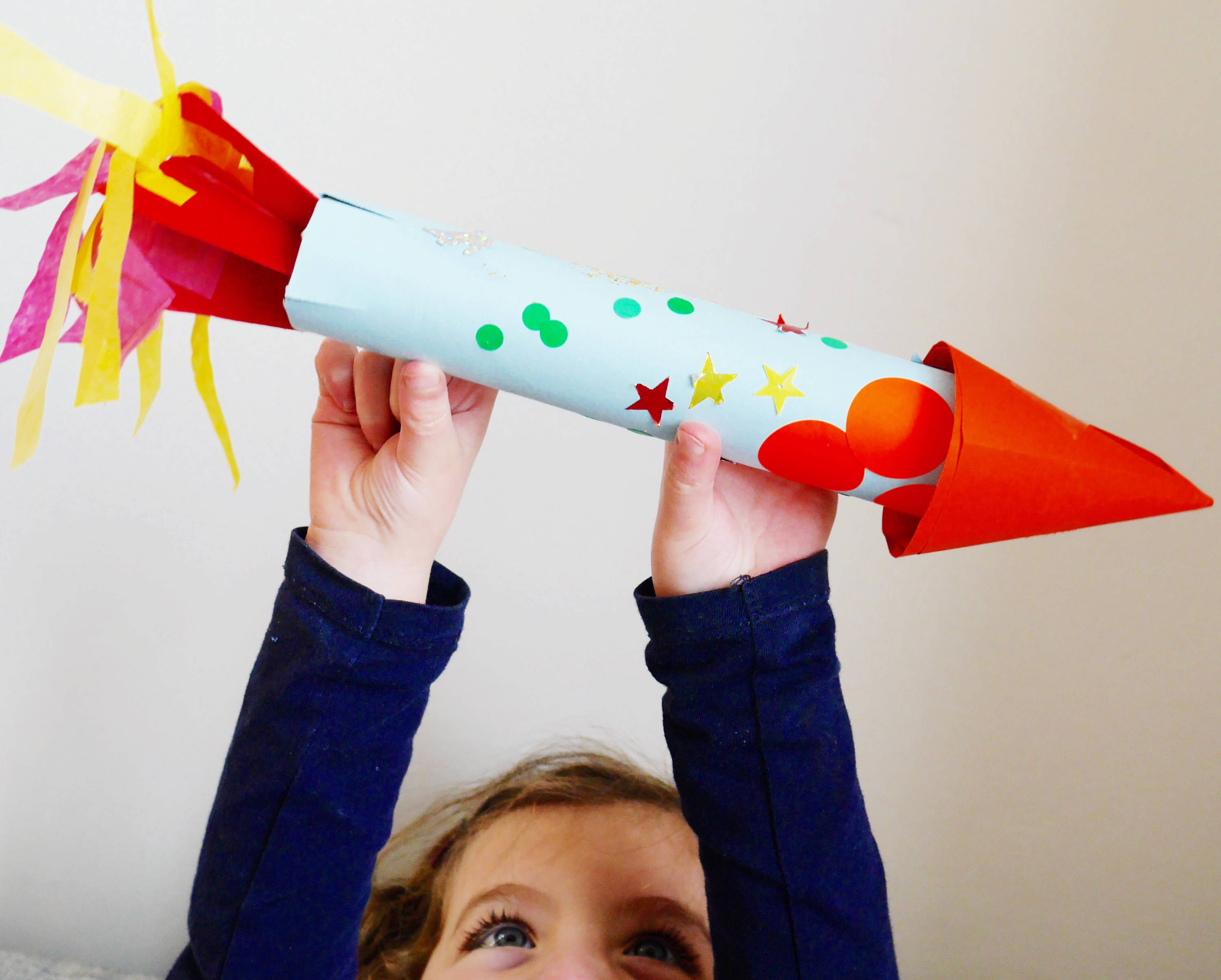 Kid Playing With Space Rocket