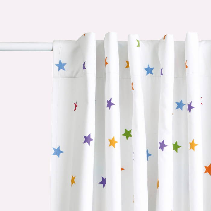 Children's blackout curtain with rainbow stardust print
