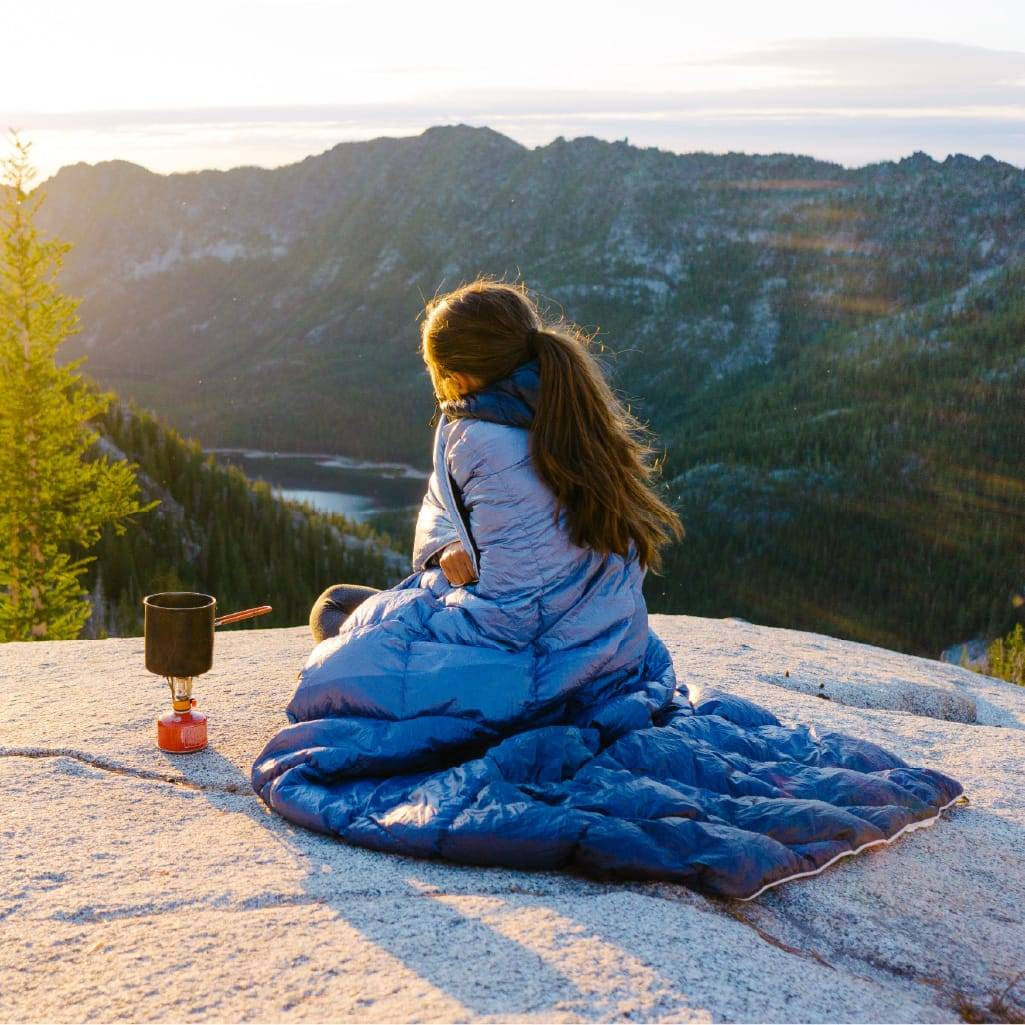 Woman sitting in National Park with Rumpl down blanket