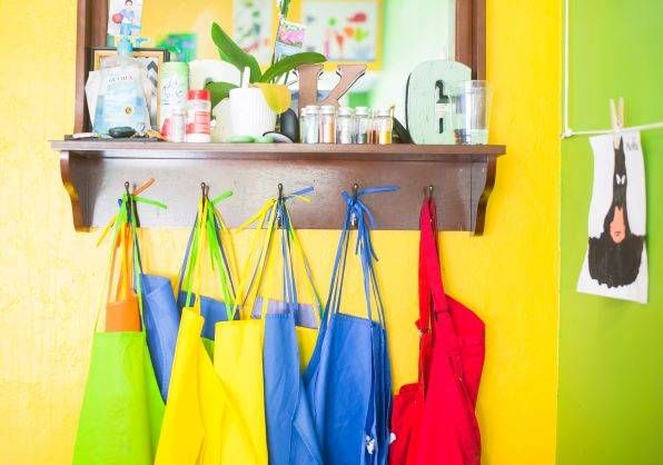 Assorted-colour Bag Lot Hanging On Brown Wooden Wall Rack