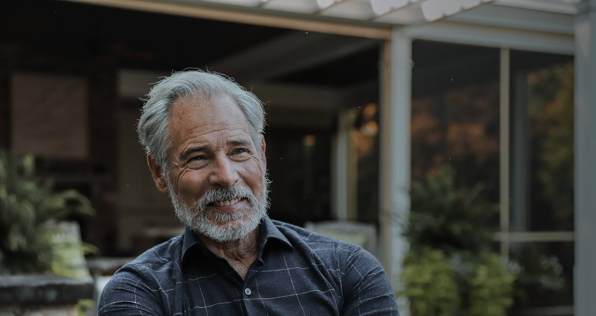 An older man wearing a Ledbury gray and white casual shirt outdoors.