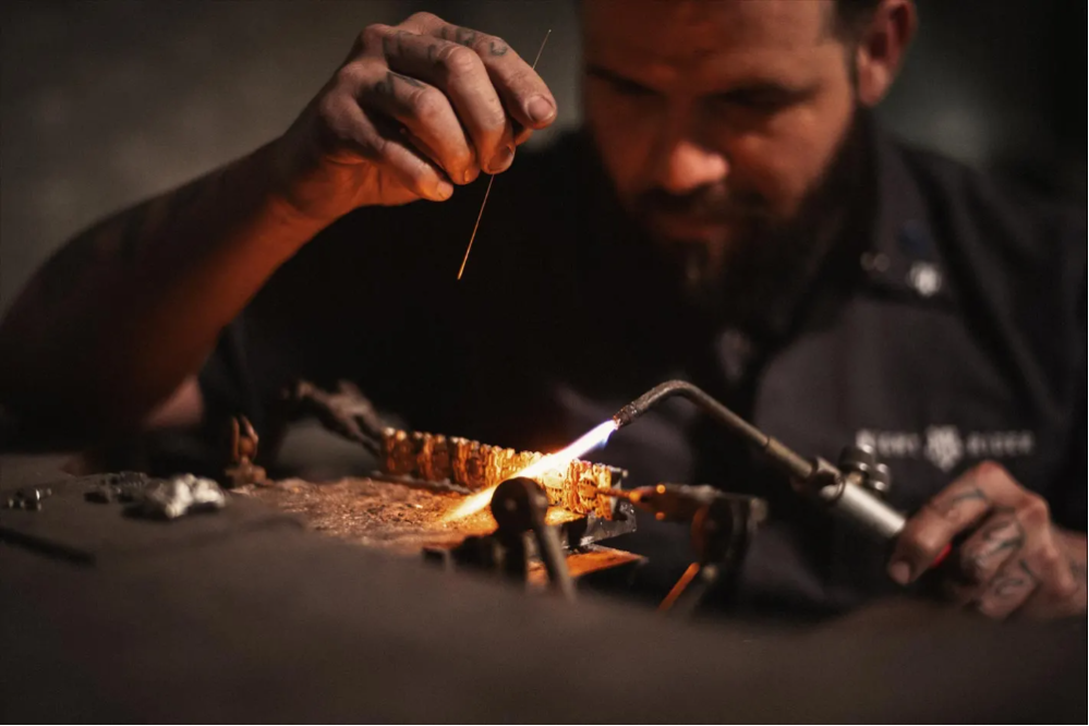 A NightRider Master Jewelry handcrafting a bracelet
