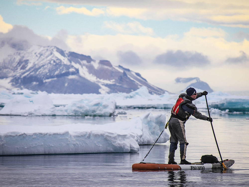 a person paddling the endurance board in antartica