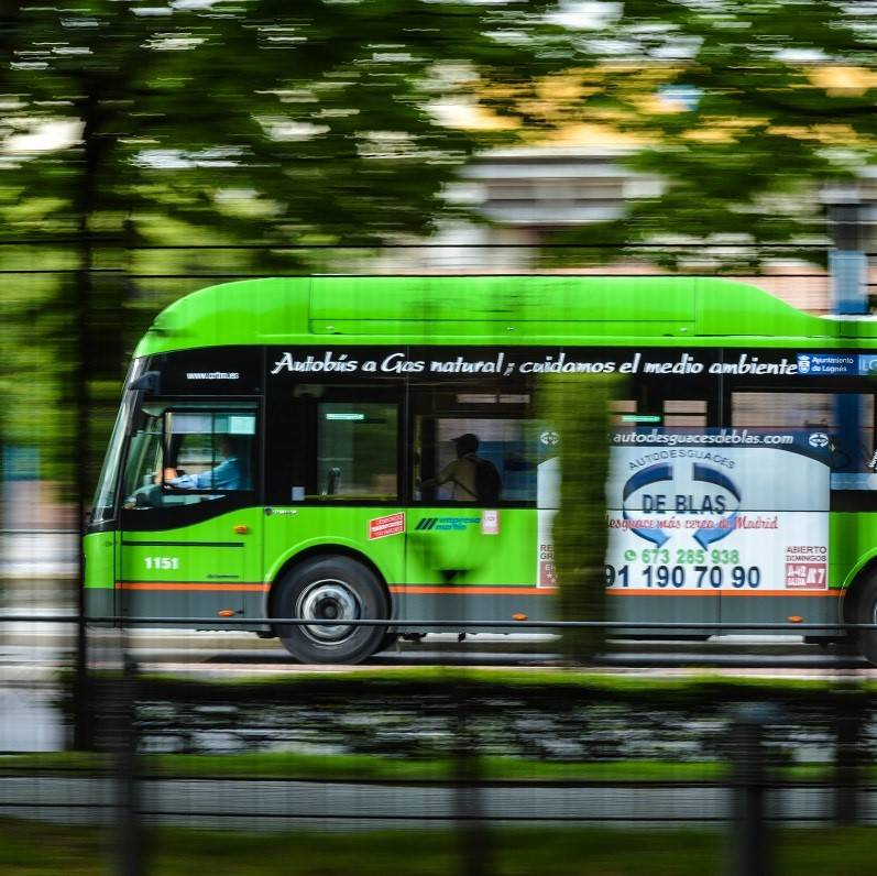 A green bus fuelled on renewables whizzes through a city