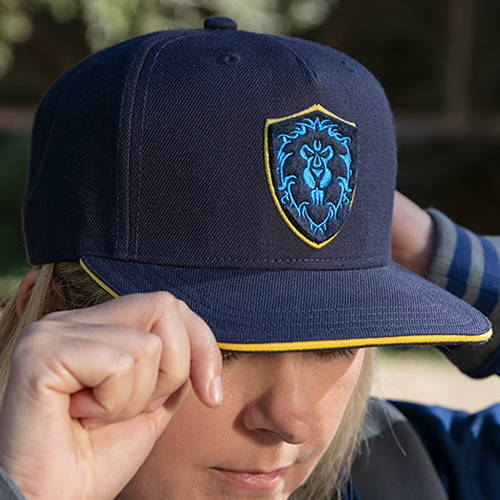 Model wearing the World of Warcraft 15th Anniversary Alliance Snapback Hat