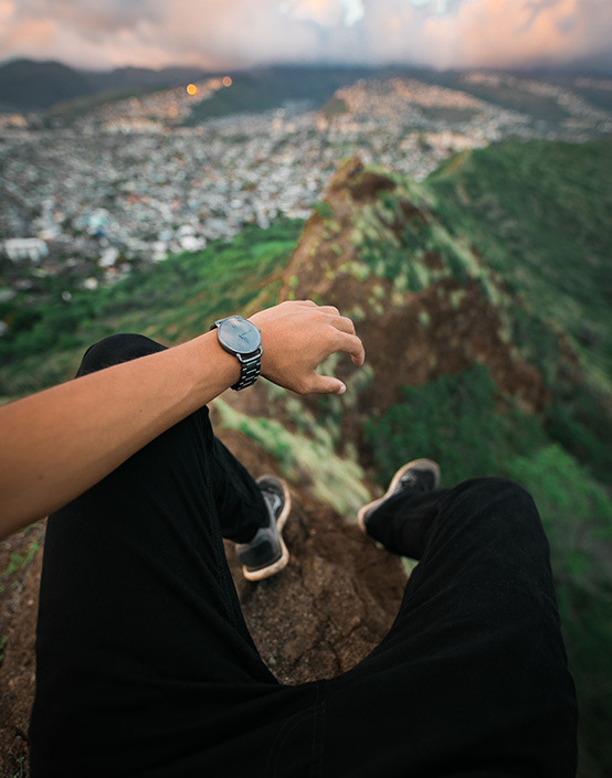 first person view wrist shot of watch on mountain