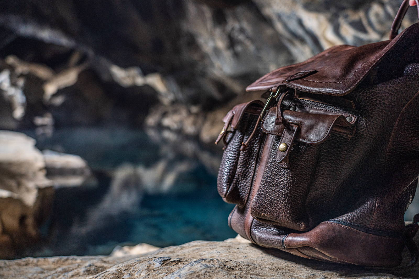 Theodore Leather Backpack next to glacier lake