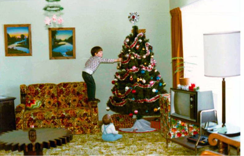 Cody Foster as a child decorating the tree