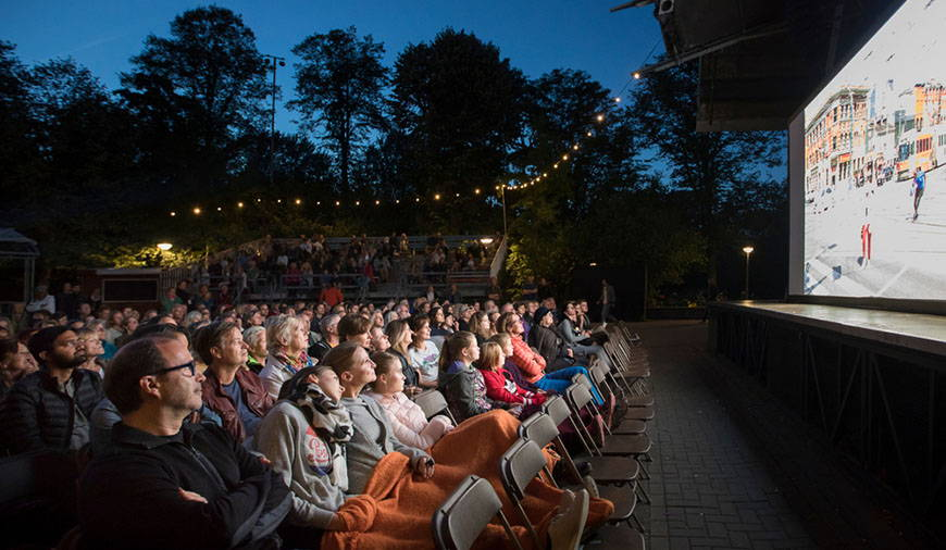 people seated at outdoor theater