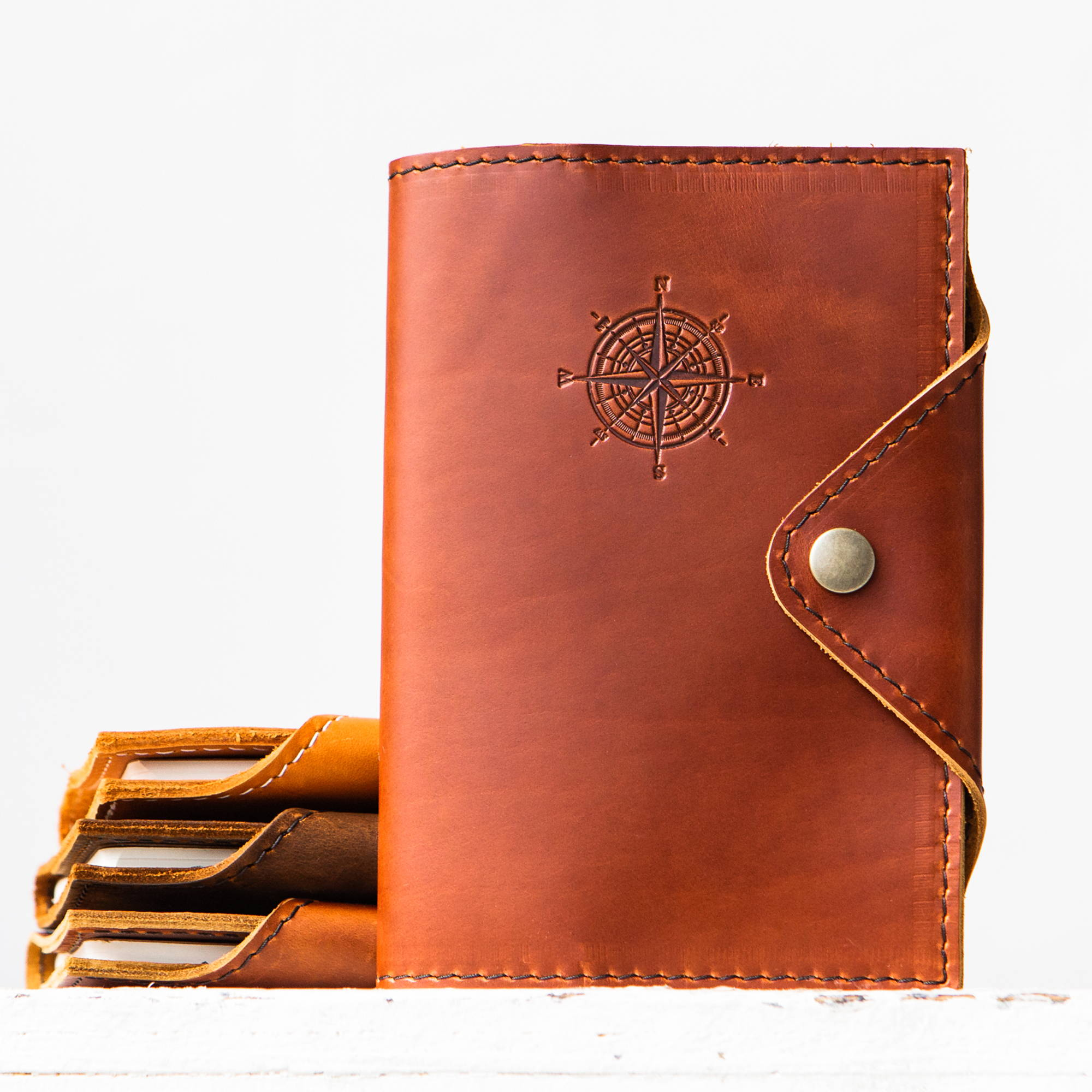 handmade leather journal covers branded with a compass rose