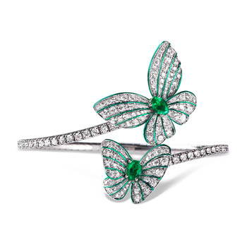 Green butterfly ring with green center gems and diamond wings