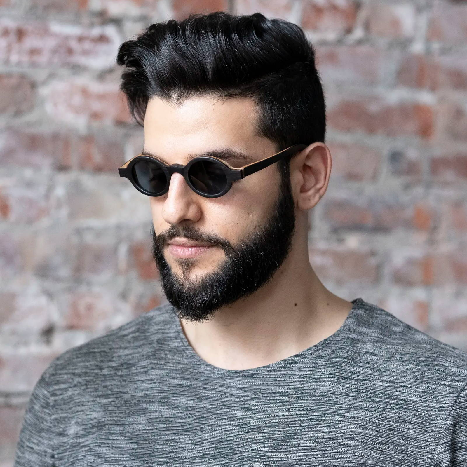 Man wearing Kraywoods Magnolia, Vintage Round Sunglasses made from Ebony wood with polarized lenses