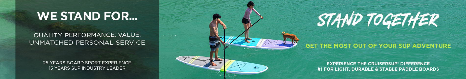A couple stand up paddle boarding with a dog