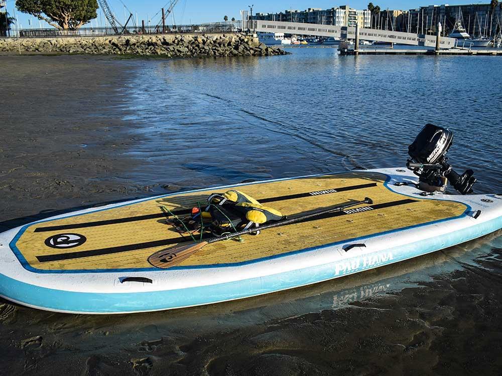 The Pau Hana Bimini SUP with outboard motor