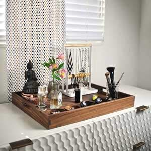 Keep all your valuable jewelry and perfume organized in the tray on your vanity or elsewhere