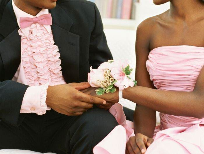 Couple dressed in pink for prom