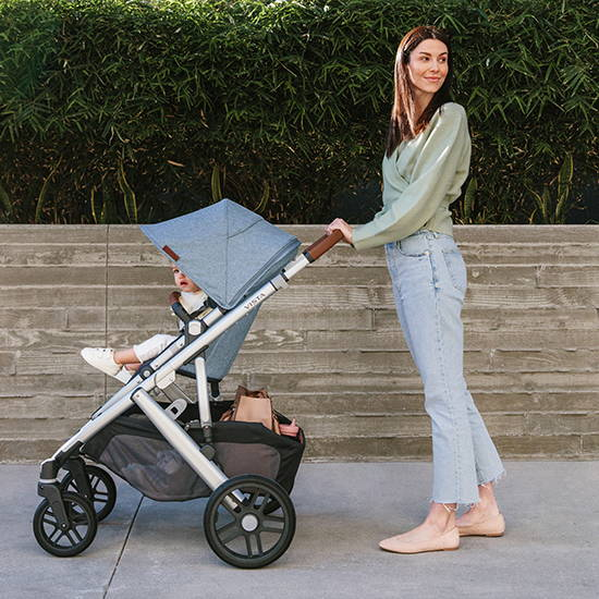 Uppababy Vista baby stroller, woman pushing a baby stroller