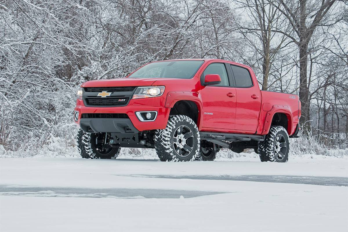 Red Lifted  Chevrolet Truck In Snow