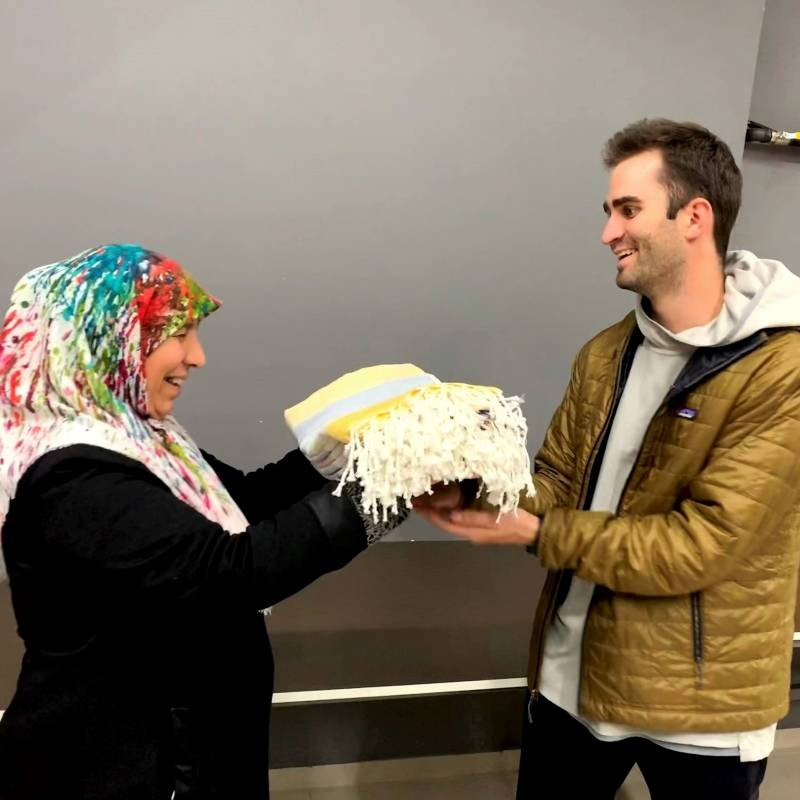 Serife, a female artisans from Kayseri, Turkey and the Founder of The Good Mark Co. exchanging gifts with huge smiles on their faces.