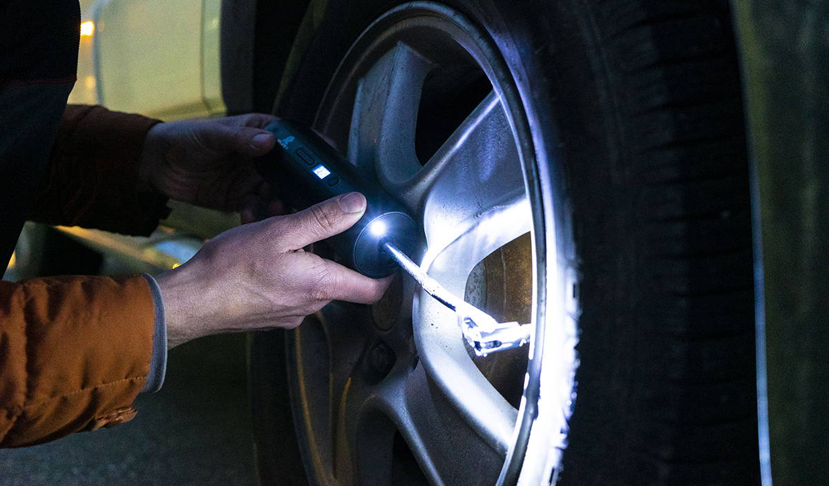 Inflate-R pumps up an emergency flat tire.