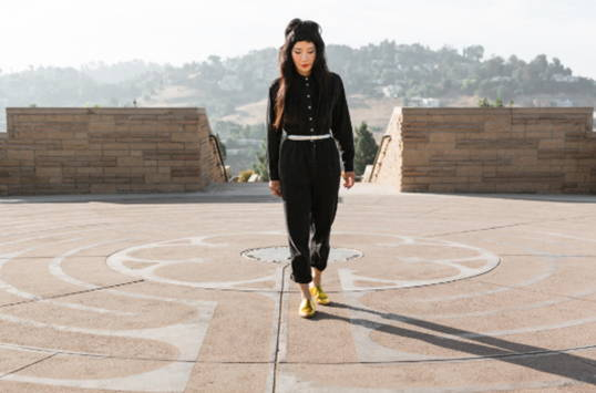 A women walking along a labyrinth and wearing Vision Quest metallic  shoes