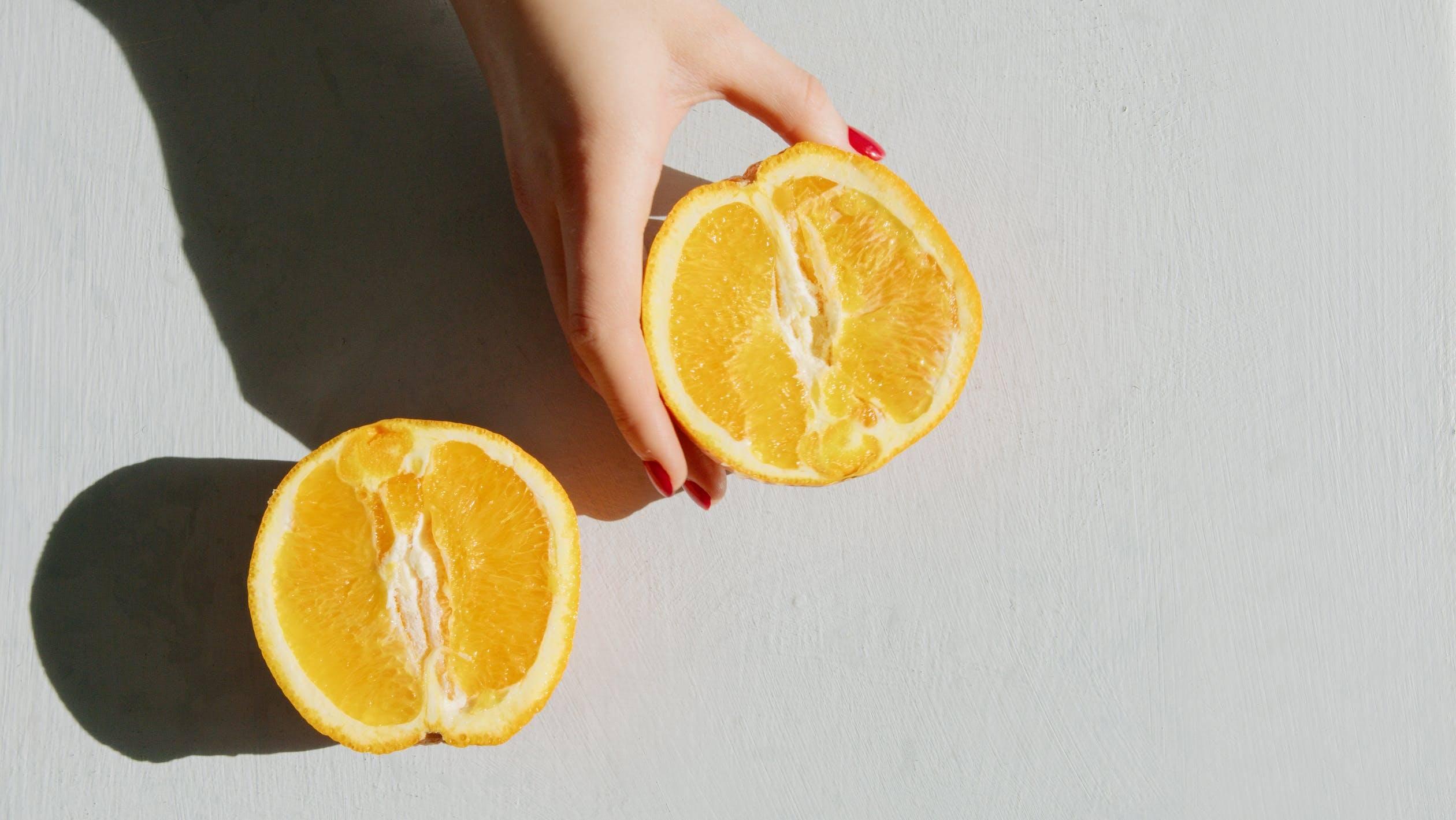 Person Holding Sliced Orange
