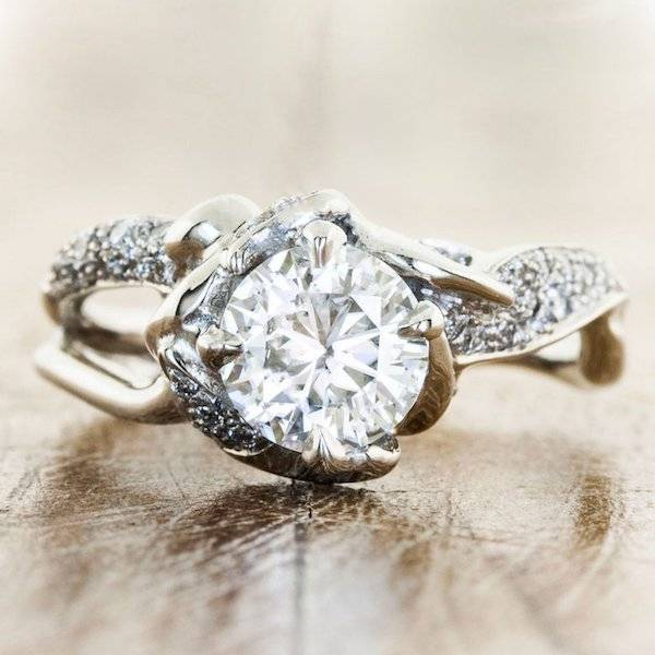 pave ring with round diamond solitaire