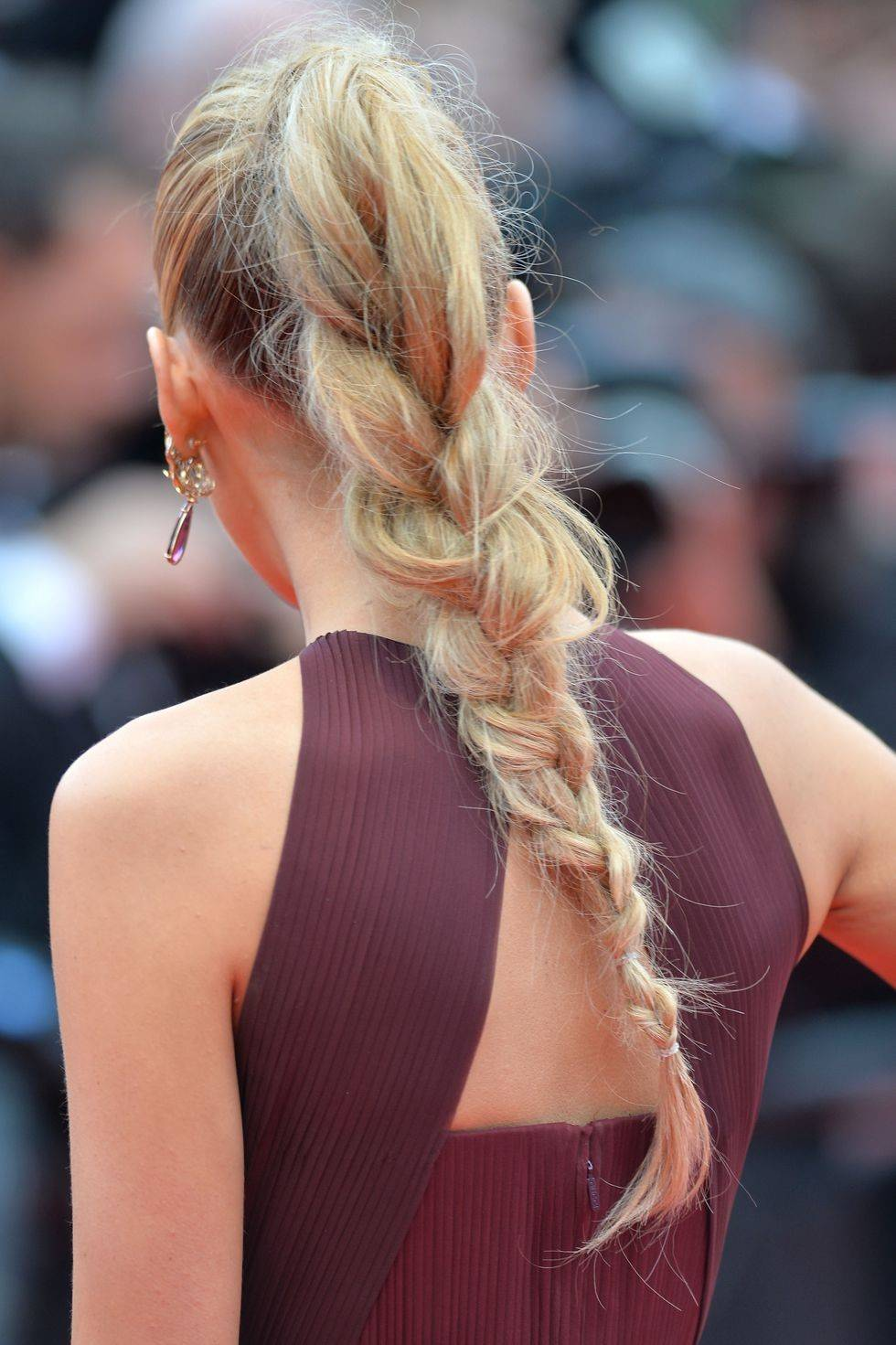 Woman with blonde ponytail braid